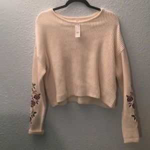 White sweater with floral embroidery